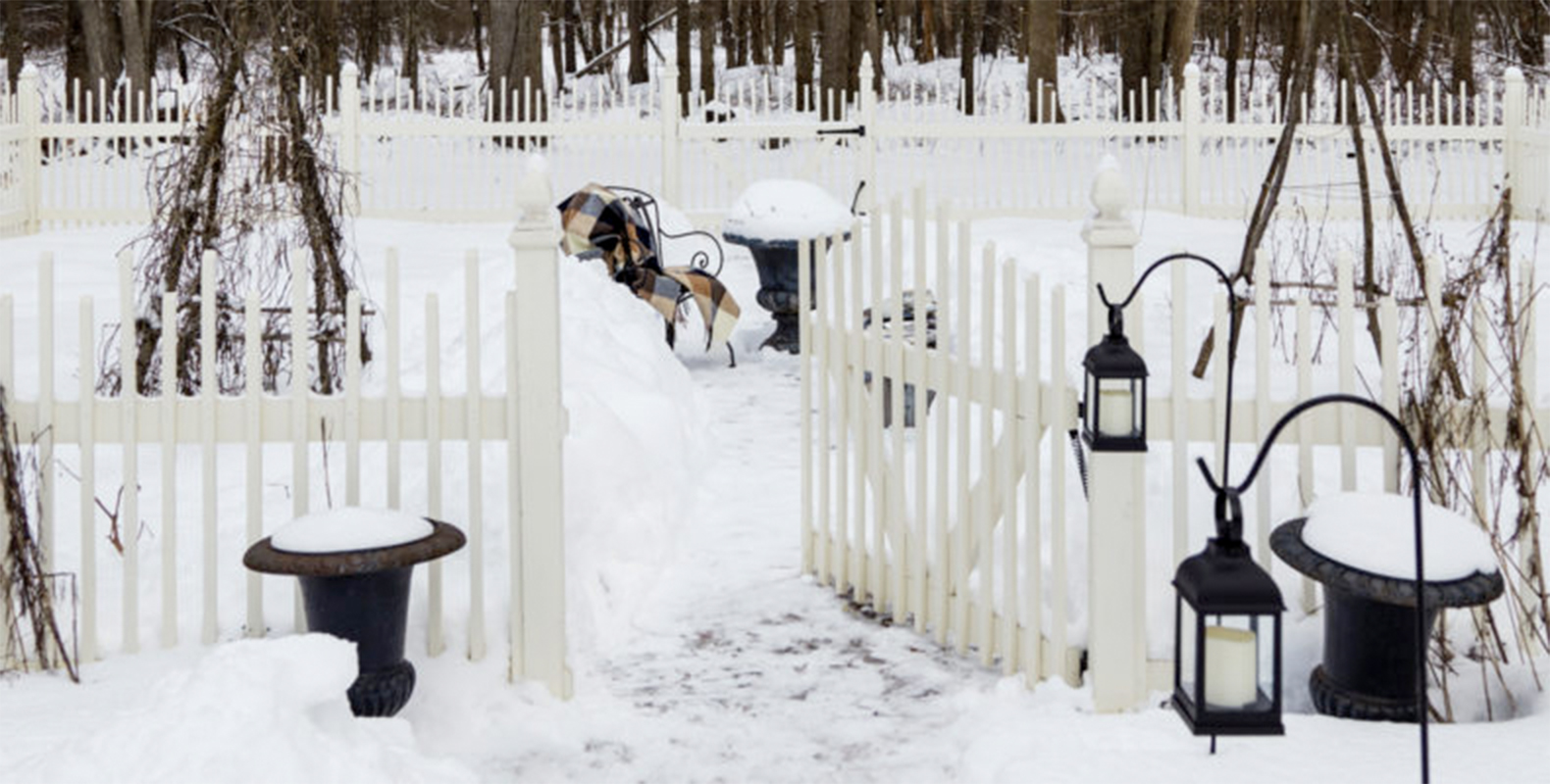 snowy yard with white gate